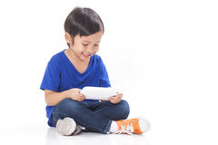 Boy playing a game on computer tablet Stock Photography