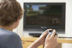 Boy Playing With Game Console. At Home Royalty Free Stock Image