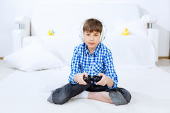 Boy playing game console Stock Photo