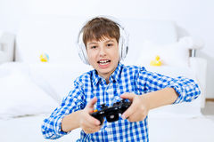 Boy playing game console Royalty Free Stock Photos