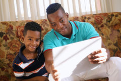 Boy Playing Game With Father On Laptop Pc Royalty Free Stock Photo