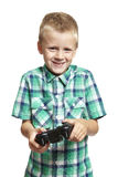 Boy playing games console Stock Photography