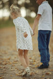 Boy playing with a girl in  autumn road Stock Photography