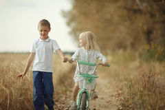 Boy playing with a girl in  autumn road Stock Image