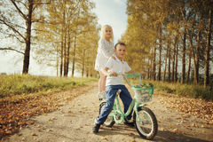 Boy playing with a girl in the autumn  road Stock Photo