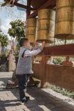 Boy rotating gold cylinder Stock Image
