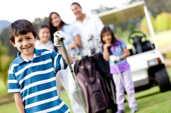 Boy playing golf Royalty Free Stock Photo