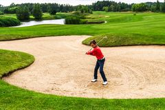Boy playing golf Stock Images