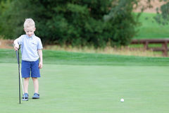 Boy playing golf Stock Photo