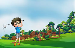 A boy playing golf at the forest Royalty Free Stock Photos