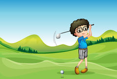 A  boy playing golf Stock Images