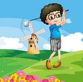 A boy playing golf Stock Photo