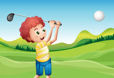 Boy playing golf Stock Image