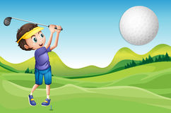 Boy playing golf Royalty Free Stock Images