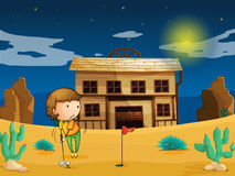 A boy playing golf infront of house Stock Photos