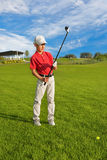 Boy playing golf Stock Photography