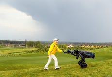 Boy playing golf Stock Photos