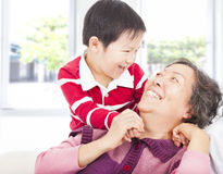 A boy playing with grandmother Royalty Free Stock Photos