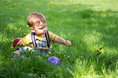 A boy playing on the grass Royalty Free Stock Photo