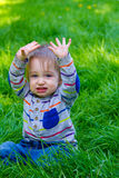 Boy Playing in Grass Stock Photos