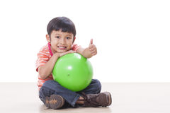 Boy playing green ball Royalty Free Stock Images