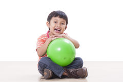 Boy playing green ball Royalty Free Stock Photos