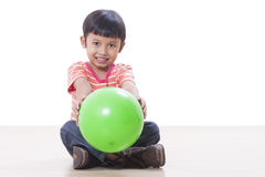 Boy playing green ball Stock Image