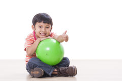 Boy playing green ball Royalty Free Stock Photo