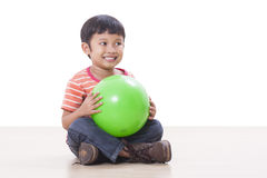 Boy playing green ball Stock Images