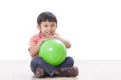 Boy playing green ball Stock Photos