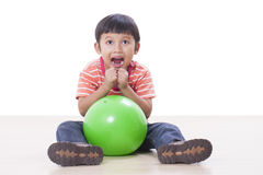 Boy playing green ball Royalty Free Stock Image