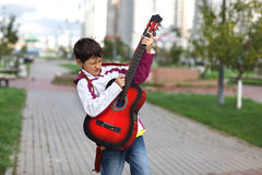 Boy playing the guita Royalty Free Stock Photos