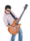 Boy playing with a guitar Royalty Free Stock Images