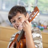 Boy playing guitar Royalty Free Stock Image