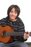 Boy playing guitar Stock Image