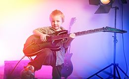 Boy playing guitar , kid guitarist . royalty free stock photography