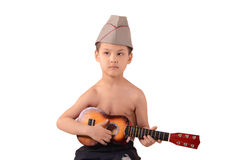 Boy playing guitar. Little boy playing guitar royalty free stock image