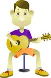 Boy playing the guitar with a melodious rhythm Royalty Free Stock Images