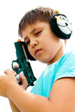 A boy playing with gun Royalty Free Stock Images