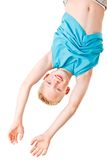 Boy playing and hanging upside down Stock Image