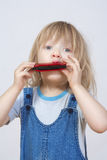Boy playing harmonica Stock Image