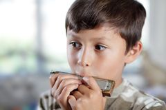 Boy personification harmonica Royalty Free Stock Photos