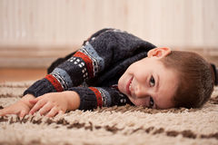 Boy playing and having fun at home stock images