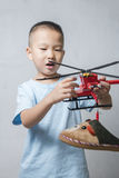 Boy playing helicopter Royalty Free Stock Image