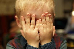 Boy playing hide and seek Royalty Free Stock Image