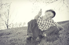 Boy Playing on Hill Royalty Free Stock Photo