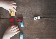 Boy playing with his cars Royalty Free Stock Photos