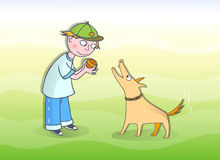 Boy playing with his dog Royalty Free Stock Photography