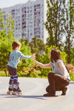 Boy playing with his mother at park Royalty Free Stock Image