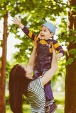 Boy playing with his mother at park Royalty Free Stock Photos
